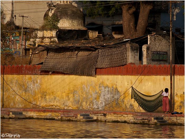 Woman hanging her sari in Udaipur, Rajasthan.