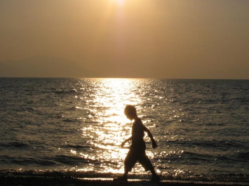 Water, sun and the boy at Lake Iznik