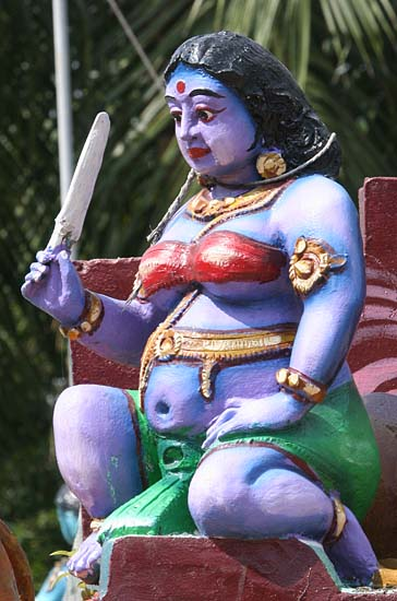Pregnant goddess on the roof of a Kaliamman temple, Tamil Nadu. http://www.blurb.com/books/3782738