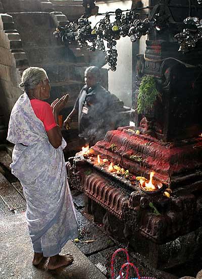Devotee at Sri Ranganatha temple in Srirangam, Tamil Nadu.