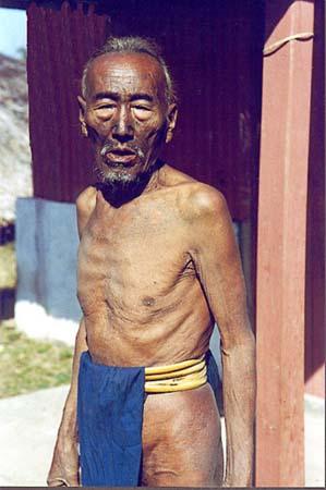 Tattoo, bamboo belt and loincloth