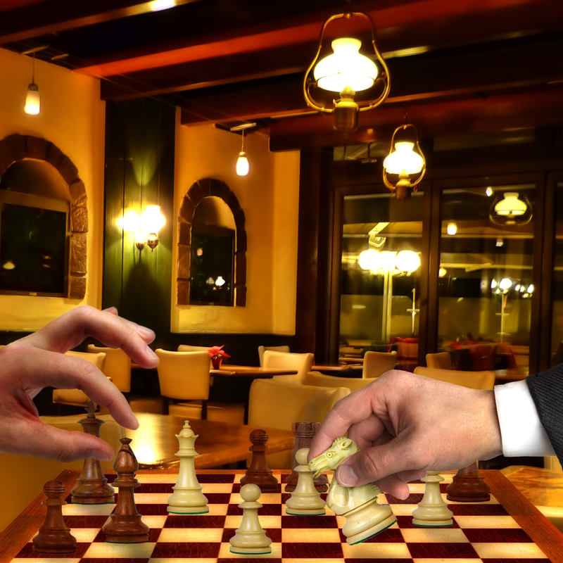 Two workers in a Southern café, enjoying a silent game of chess.