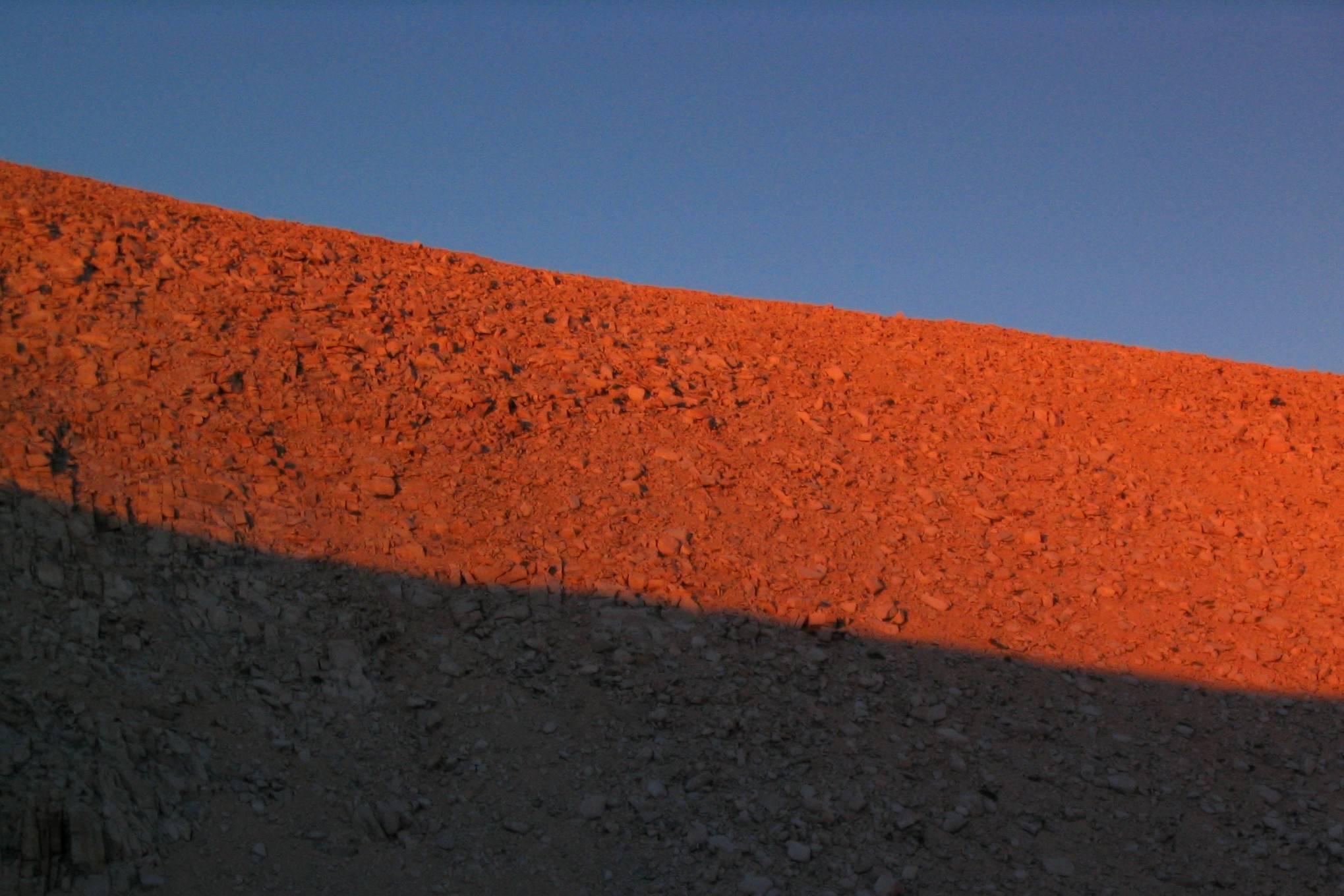 Sunset color bands on ridgeline