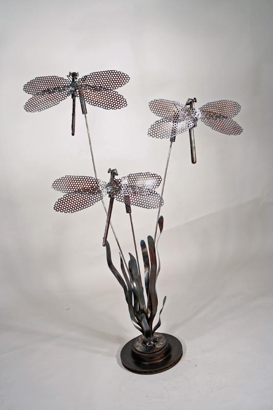 three draygonflies