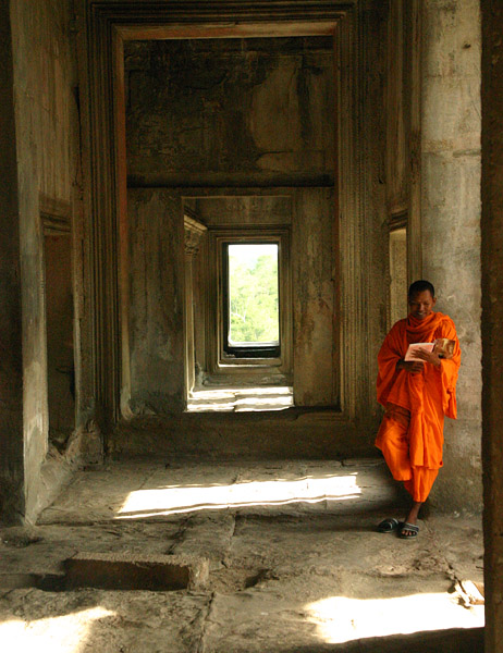 Lone Monk, Angkor Wat, Cambodia. Not exactly the most peaceful place to study, but good if you want your photo taken...