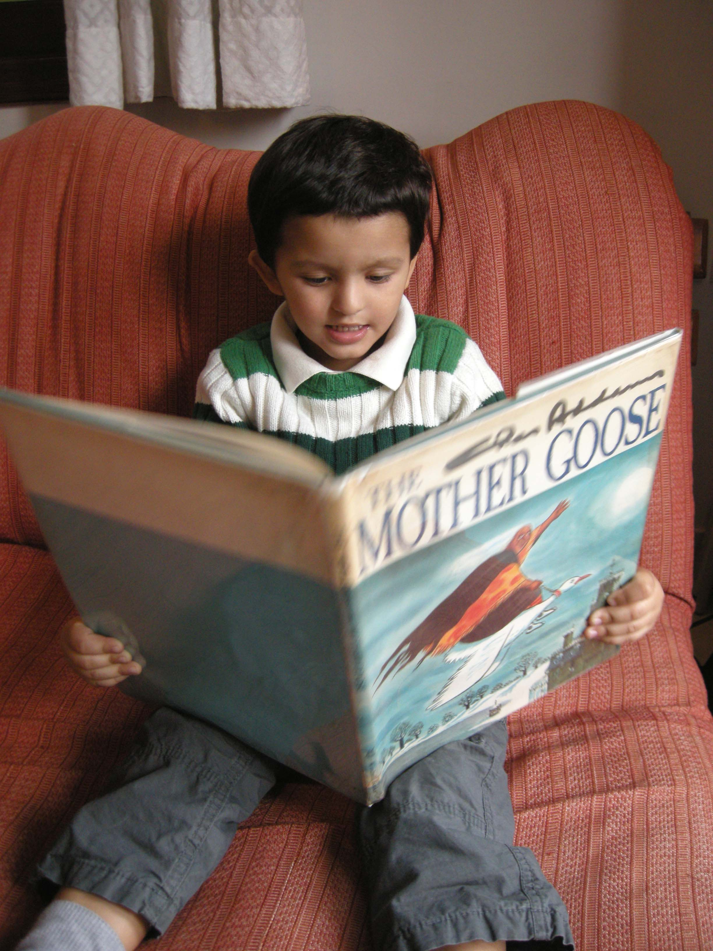 Rahil reading The Chas Addams Mother Goose