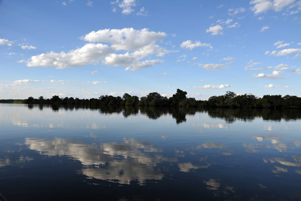 Clouds reflecting in the calm Kafue River