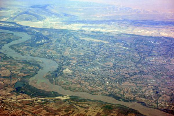A canal joins the Amu Darya River, Uzbekistan (N41 46.6/E060 33.2)