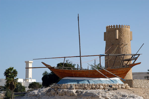 Dhow and watchtower near the Al Khor Corniche