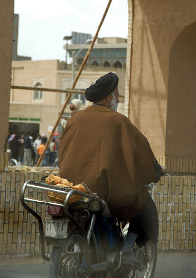 Mullah on a moped