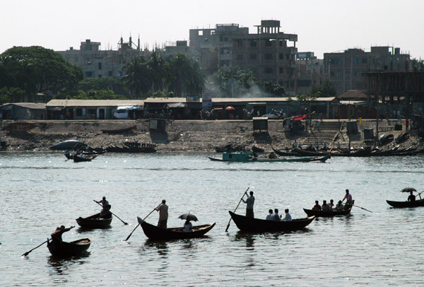 Ferrymen (sampan walas) ply across the Buriganga River in a timeless scene a far cry from the romance of Venetian goldoliers