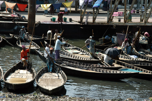 Small wooden sampans lined up waiting to ferry passengers across the Buriganga, Old Dkaha