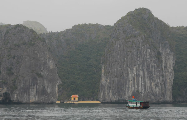 A small temple on a beach off the east coast of Cat Ba Island, Halong Bay