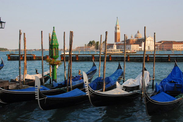 Gondolas tied up along the Molo in front of the Doges Palace, Venice