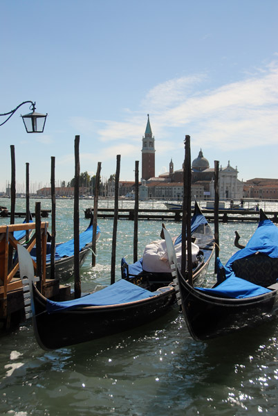A pair of gondolas in front of the Doges Palace