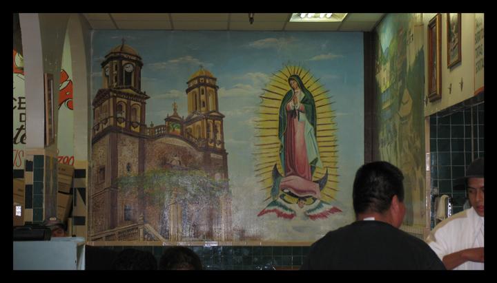 Virgin mural  a taco stand in El Mercado.