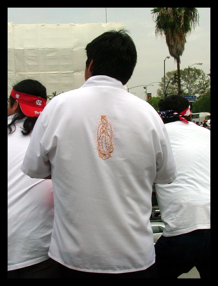 Virgin on his shirt