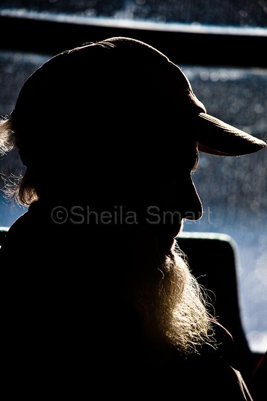 Rimlight man on ferry