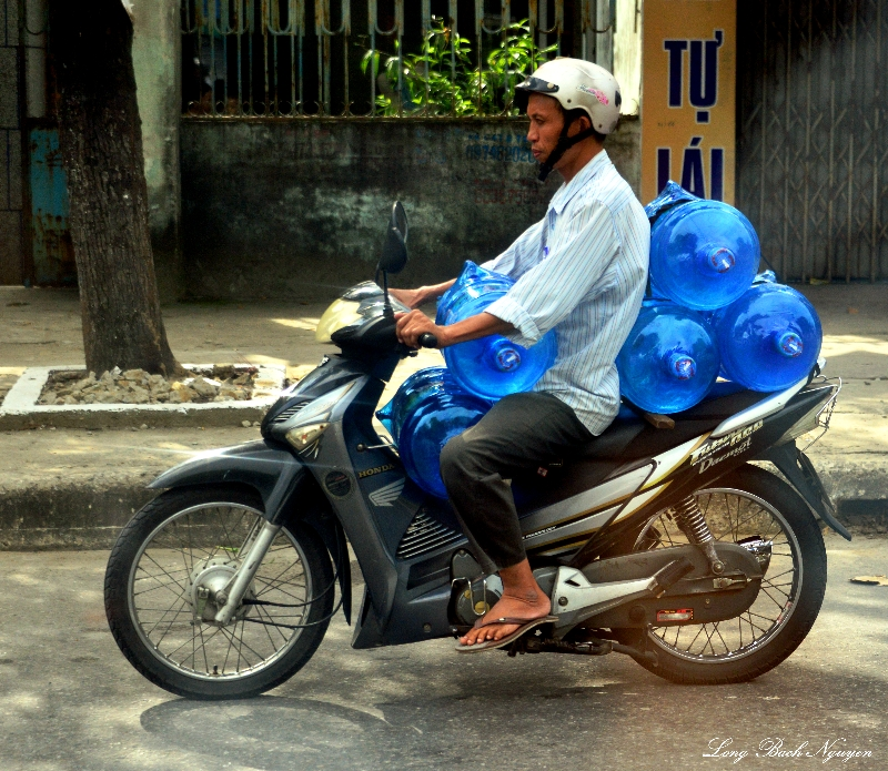 water delivery on scooter, Vietnam