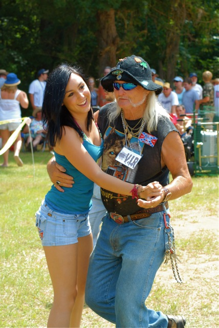 Redneck Games Mascot Freight Train Dancing with Young Lady in Crowd.