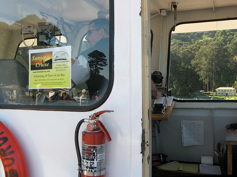 Ferry s wheel man.   Islands Admin bldg in view