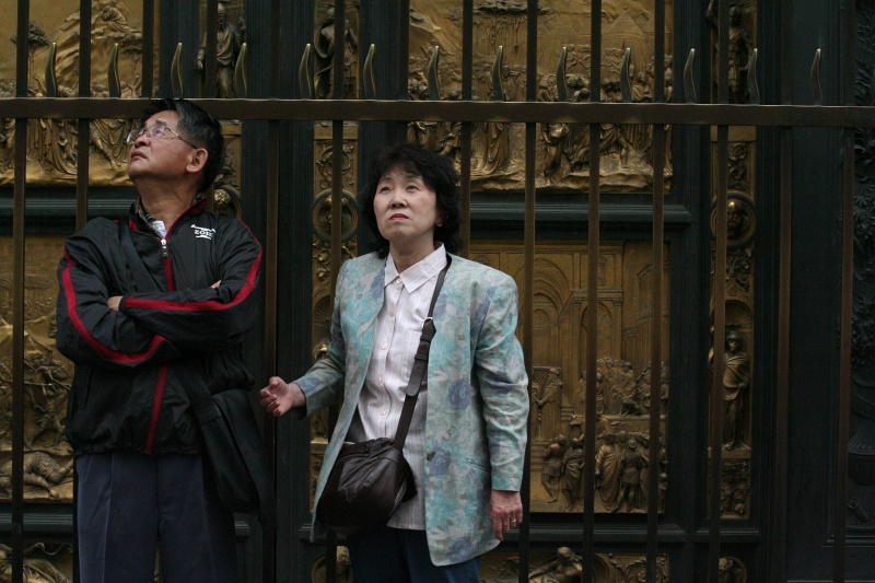 Tourists at Baptistery doors perusing the Duomo