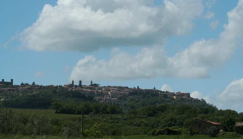 From the car, approaching Montalcino, fortress at left