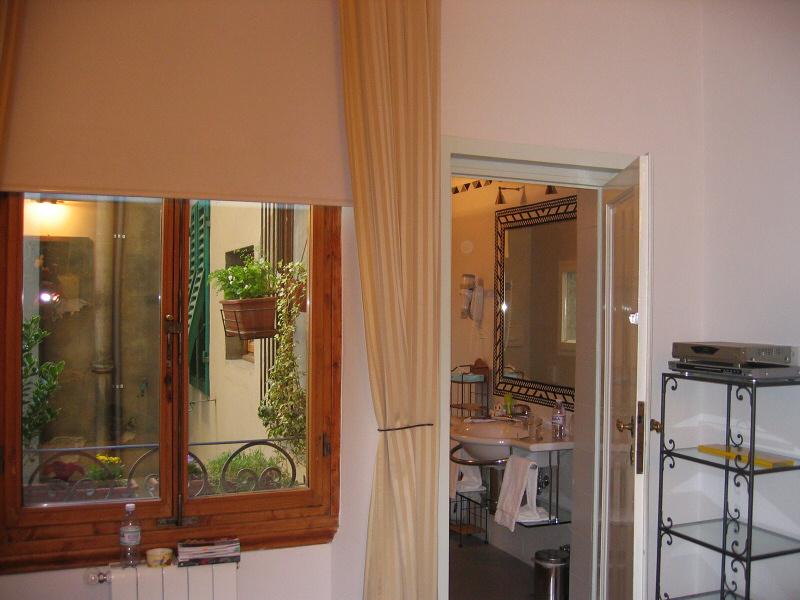 Patio outside, great bathroom, spacious shelving