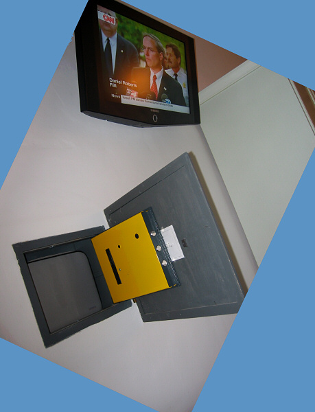 Wall safe for my laptop.  Tv above and closet with small fridge.