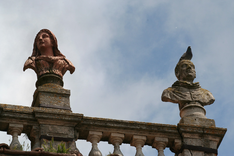 Statues closer up - dignity of the 2nd one is ruffled by pigeon on head.