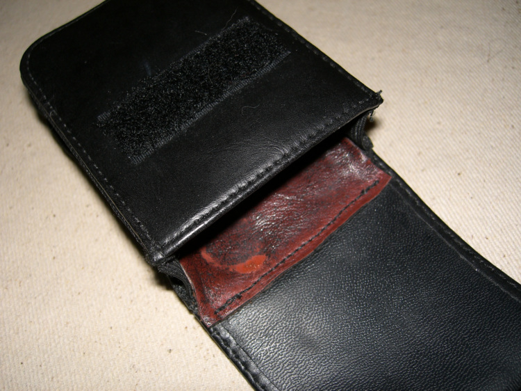 New inside leather flap sewn on, simple and effective.