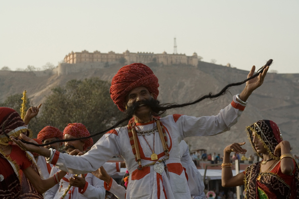Elephant Festival dancer with fort in background.jpg