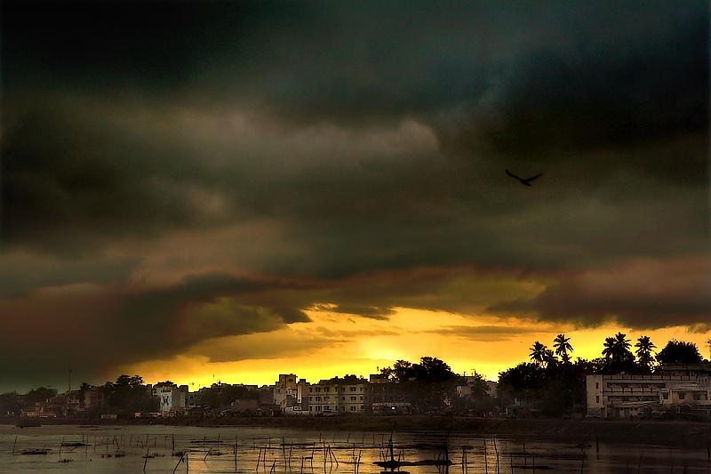 Sun breaking through thunder clouds