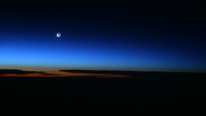 Sunrise and Moonrise (Waning Crescent) over North Pole 37,000 ft
