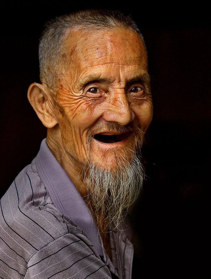 Kam elder, the father of the village leader.