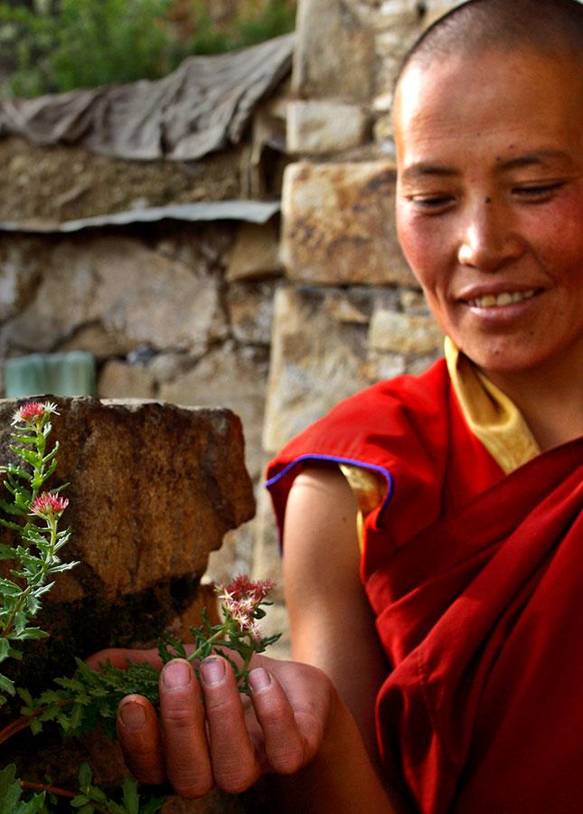 Ani (nun) near her high mountain homes near Lhasa, Tibet.