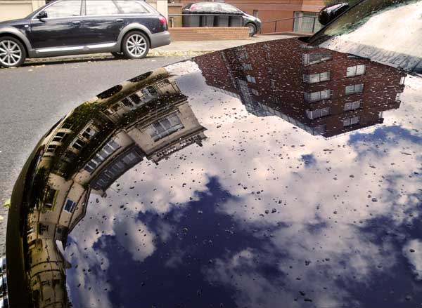 Reflection on His Car