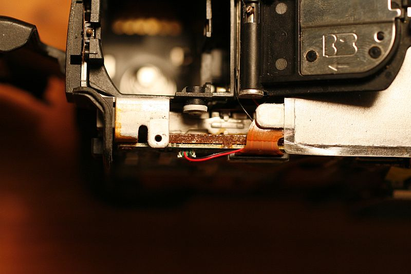 Detail - behind/below battery door.
