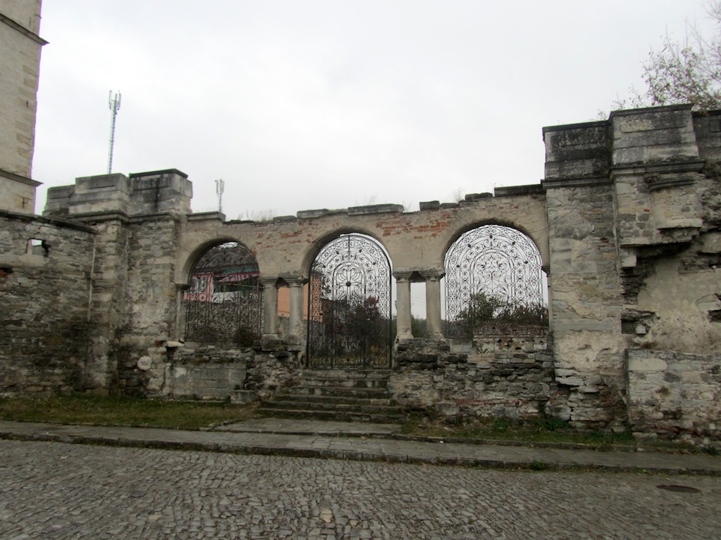 the gate to the garden where the church once stood