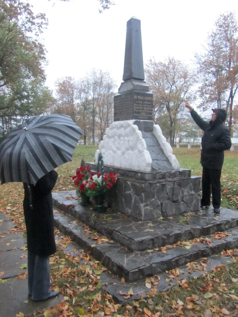 ...in a field where over 20,000 Jews from the city and deported from Hungary were killed