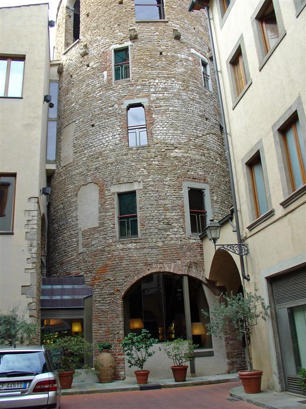 An ancient tower, now part of a modern hotel