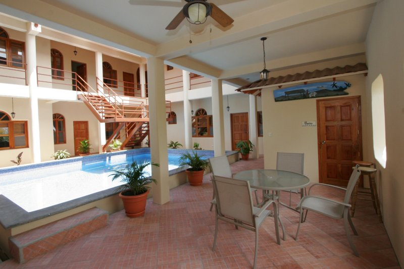 downstairs patio and pool area