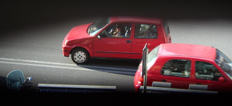 Rome cars from window through slats