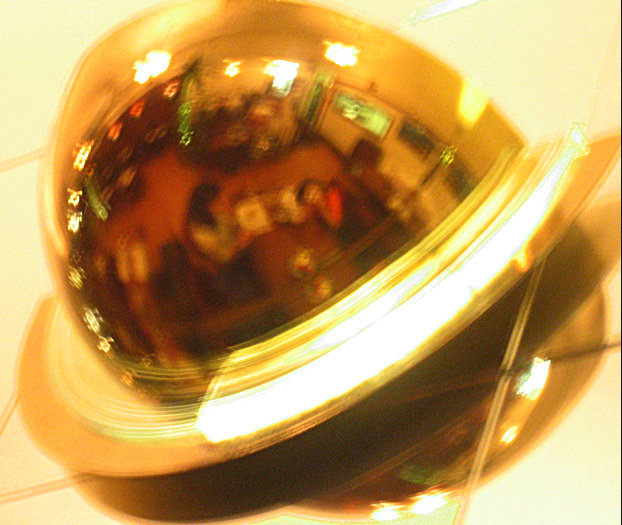 restaurant lamp reflection, 1/2 sec and blurred