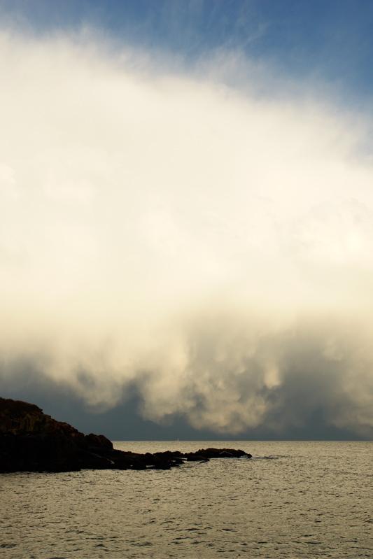 75DSC03419.jpg deatil of stormfront behind nubble lighthouse over dist boon light