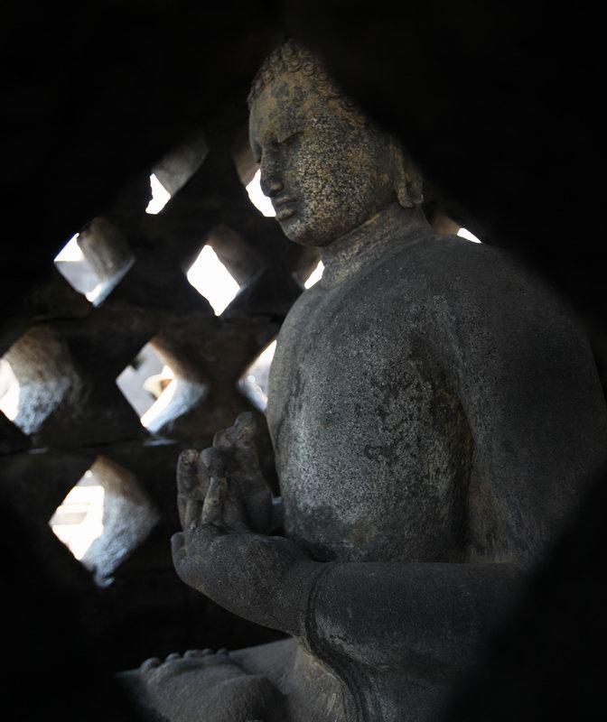 Buddha in a Stupa at Borobudur