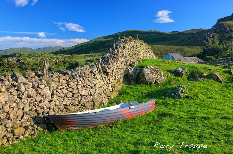 Retired fishing boat in a field