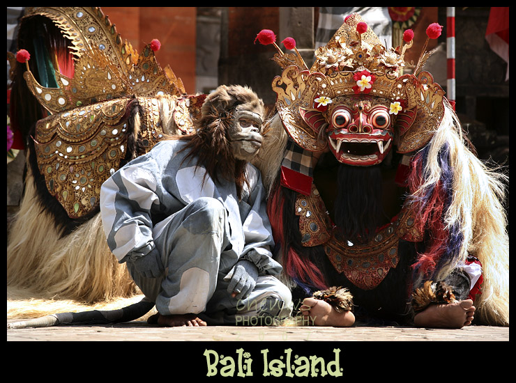 BALI, INDONESIA - OCTOBER 24: The monkey discusses with the mystical beast Barong in a staged performance at an outdoor theatre