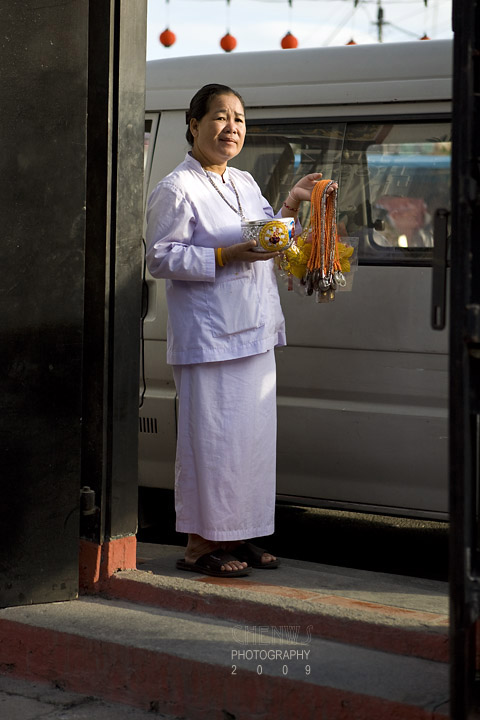 Nun asking for alms at temple door
