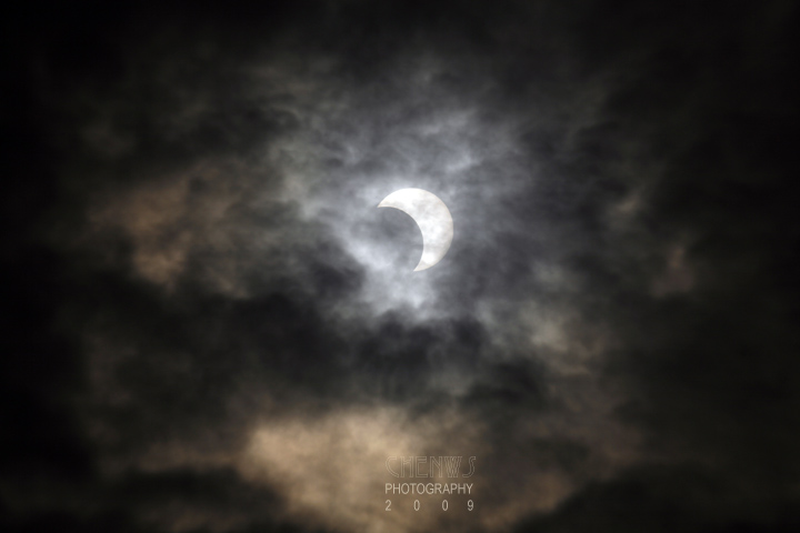 MALACCA, MALAYSIA - JANUARY 26: A partial solar eclipse as viewed from a reflection from a pool of water on January 26, 2009 in